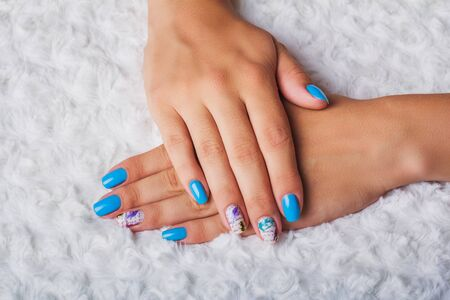 naildesign: Light blue nail art with feathers print on light background