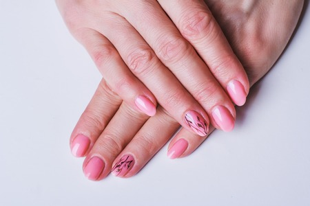 Pink Nail Art With Flowers On White Background Stock Photo Picture