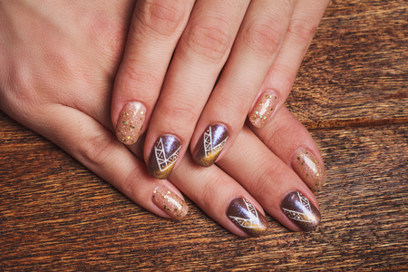 Gold Nail Art With Tinsels On Wooden Background Stock Photo Picture