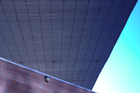 Low angle view of a building structure under a bridge overpass in New York City
