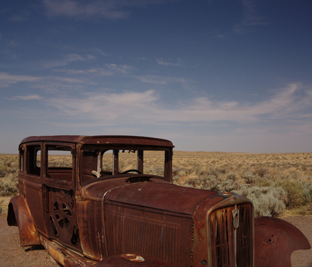 rusty car: An abandoned and rusty car in the desert in Petrified Forest National Park in the southwest US Stock Photo