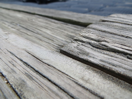 uneven: Several lanes of uneven vintage or retro wooden floor on which grows some lichens Stock Photo