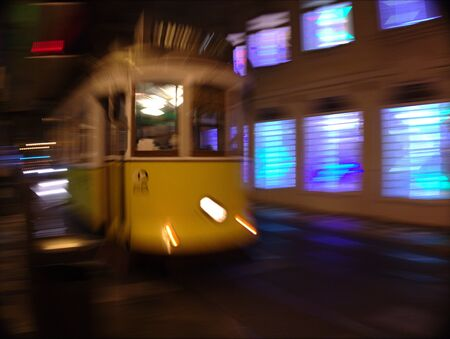 suggesting: Front and blurry view of a moving streetcar suggesting speed