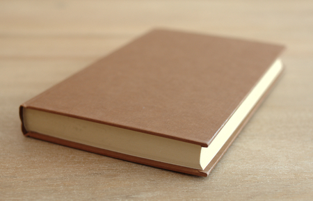 bookcover: Side view of an old book on a table