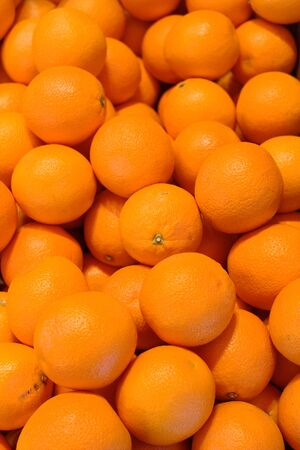 consumed: Multiple fresh oranges ready to be consumed
