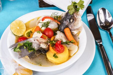 Mediterranean fish soup with vegetables and lime