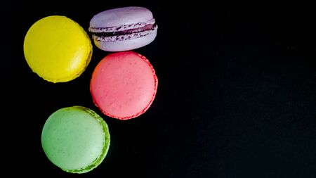 Macaroons cookies on a dark canvas background. view from above. copy space