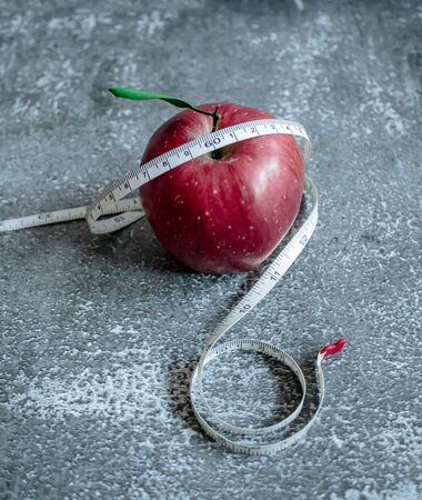 red apple for weight loss while dieting, centimeter measuring tape