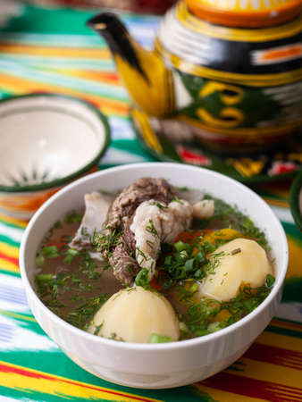 Surpa Soup from Boiled beef, potatoes and onions according to an oriental recipe. Eastern cuisine, national dish