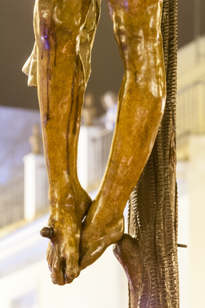 Detail of the feet nailed to the cross of the sculpture of the crucified Christ of the brotherhood of Stock Photo