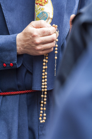 Detail of the hand of a penitent of the brotherhood of