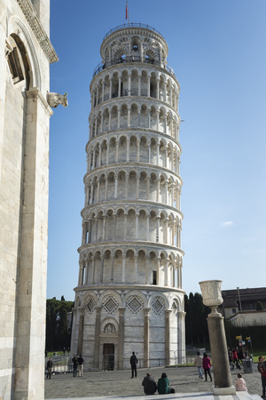 Tower of Pisa with a blue sky in the background.