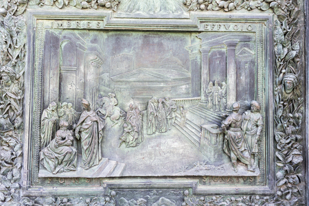 Detail of a bronze high relief of the door of the cathedral of Pisa