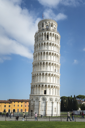 Tower of Pisa with a blue sky with white clouds in the background.