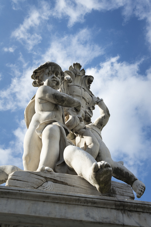 Marble sculpture with a blue sky with white clouds in the background