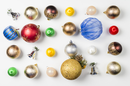 Composition with balls and Christmas decorations on white background.