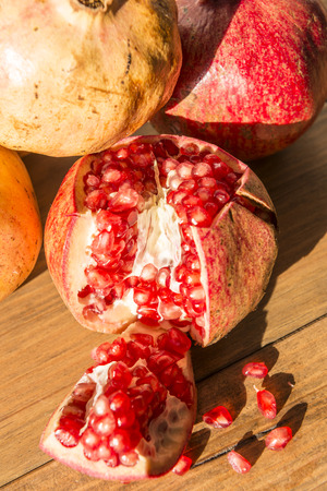 Healthy food concept. Still life with pomegranates on wooden table. Banque d'images - 121793216