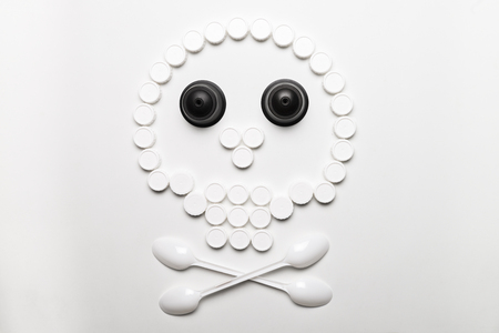 Conceptual and metaphorical photography of a skull made with plastic stoppers.