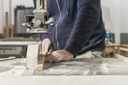 Worker man concept. Male carpenter working in his carpentry workshop.