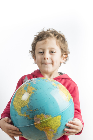 Conceptual photography of a child holding a globe in his arms. Banco de Imagens