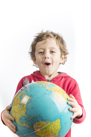 Conceptual photography of a child holding a globe in his arms. Archivio Fotografico