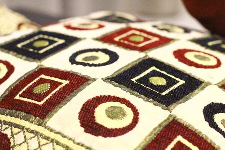 A close shot of the fabric on a pillow to reveal the pattern on it
