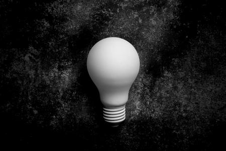 white light bulb on on dark background. monochrome Foto de archivo