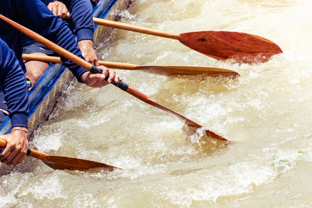 Hand closeup of a men are boating in rowing racing. - thailand classic sport.