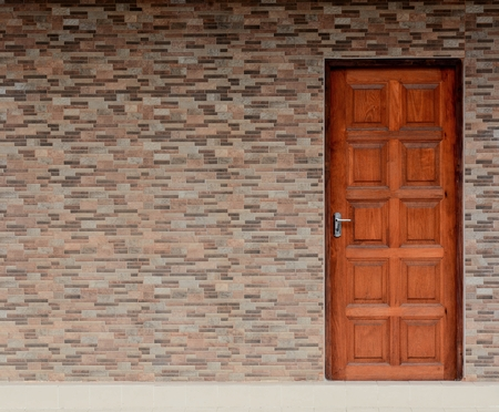 wood door and ceramic brick wall