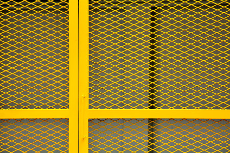 yellow cage metal wire - background