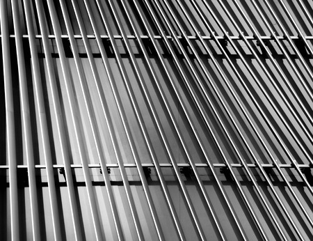 Abstract close-up view of modern silver ventilated on building Banco de Imagens