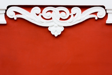 Beautiful luxury floral pattern on red decorative plaster wall