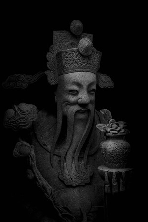 stone chinese nobility statue in thailand temple Banque d'images