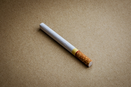 a cigarette on recycled craft paper Stock Photo