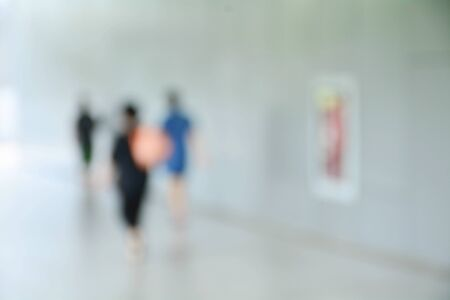 blurred image of people at sidewalk in the city. Stock Photo