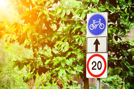 blue bicycle sign in the park.