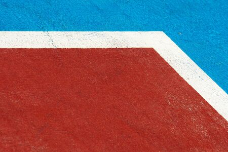 closeup blue and red basketball court