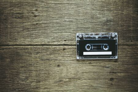 vintage audio cassette tapes on wooden background. - vintage backdrop style. 版權商用圖片
