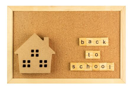 small model school and back to school word on cork board in wooden frame isolated on white background. Stock Photo