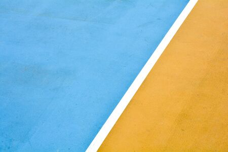 white line with yellow and blue basketball court