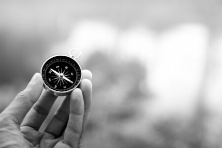 compass in the hand. - dark concept