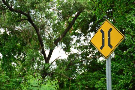 Narrow bridge sign in country road