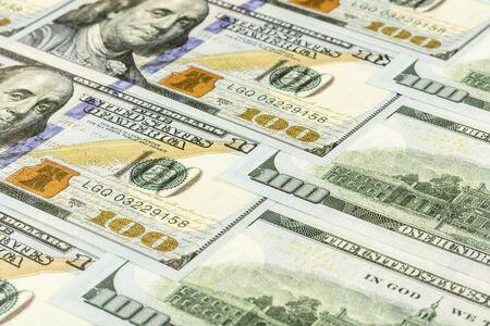 Pile of hundred dollar banknotes. - Business backdrop.
