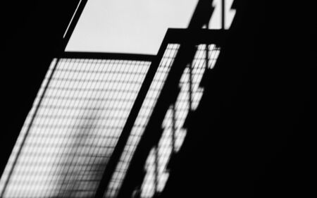 shadow of fire escape stair on cement wall