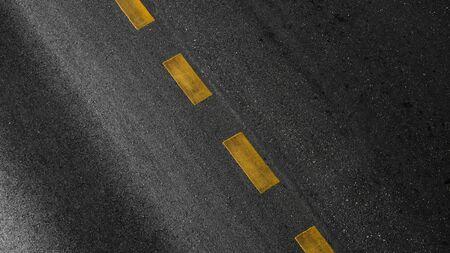 yellow paint line on black asphalt. space transportation background