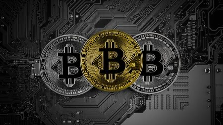 golden and silver bitcoins on circuit board.