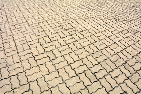 patterned paving tiles, old cement brick floor background Stock Photo