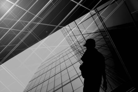 silhouette of a lonely man and the abstract architecture building. for business concept background. Reklamní fotografie