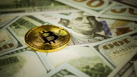 bitcoins on pile of a banknote background. - business and economy concept.
