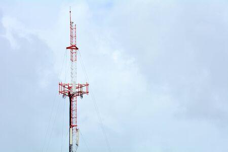 Cellular antenna against blue sky in summer